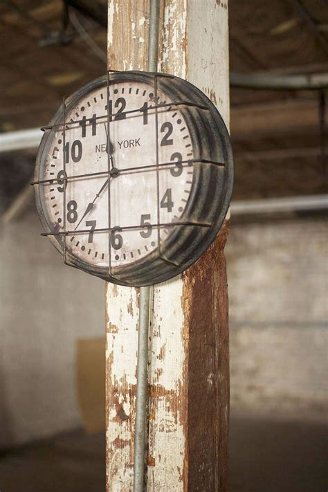 caged metal new york factory clock