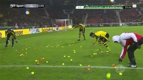 Borussia Dortmund fans bombard pitch with tennis balls in