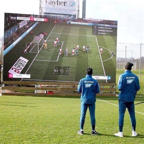 Hoffenheim Players Play FIFA on Giant Screen at Training